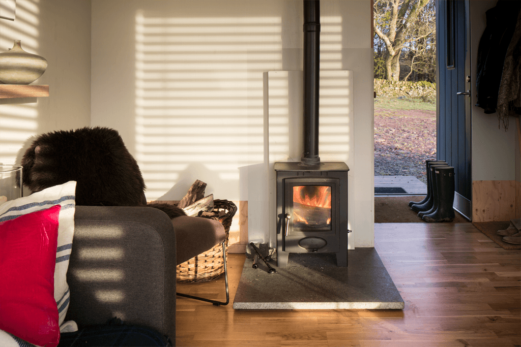 <em>Boutique Eco Retreat</em> | Cosy evenings by a warm wood burner